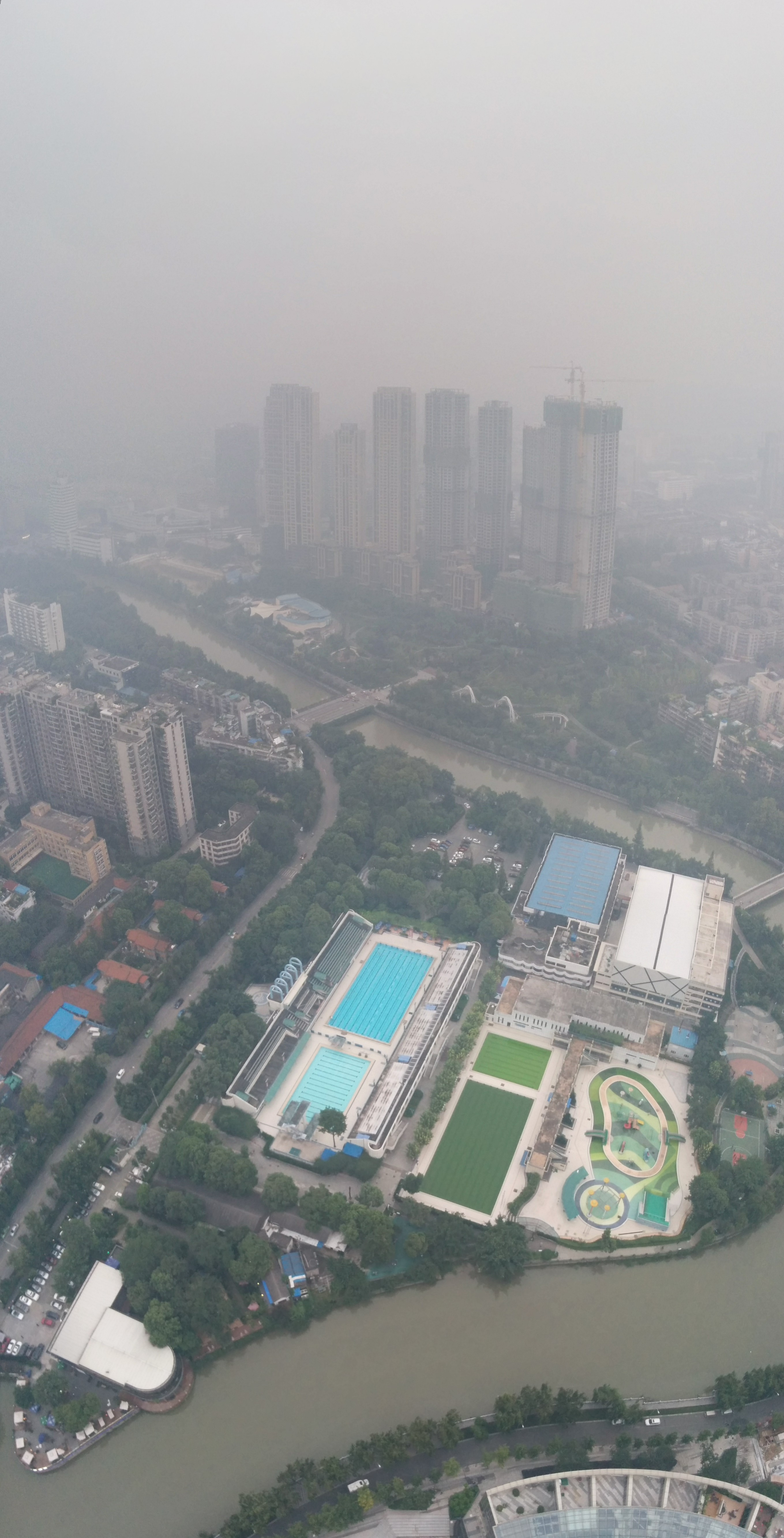 Looking down at the Mengzuiwan swimming pools on the north side of the Tower.
