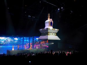 A temple is suspended from the ceiling as the show comes to a close