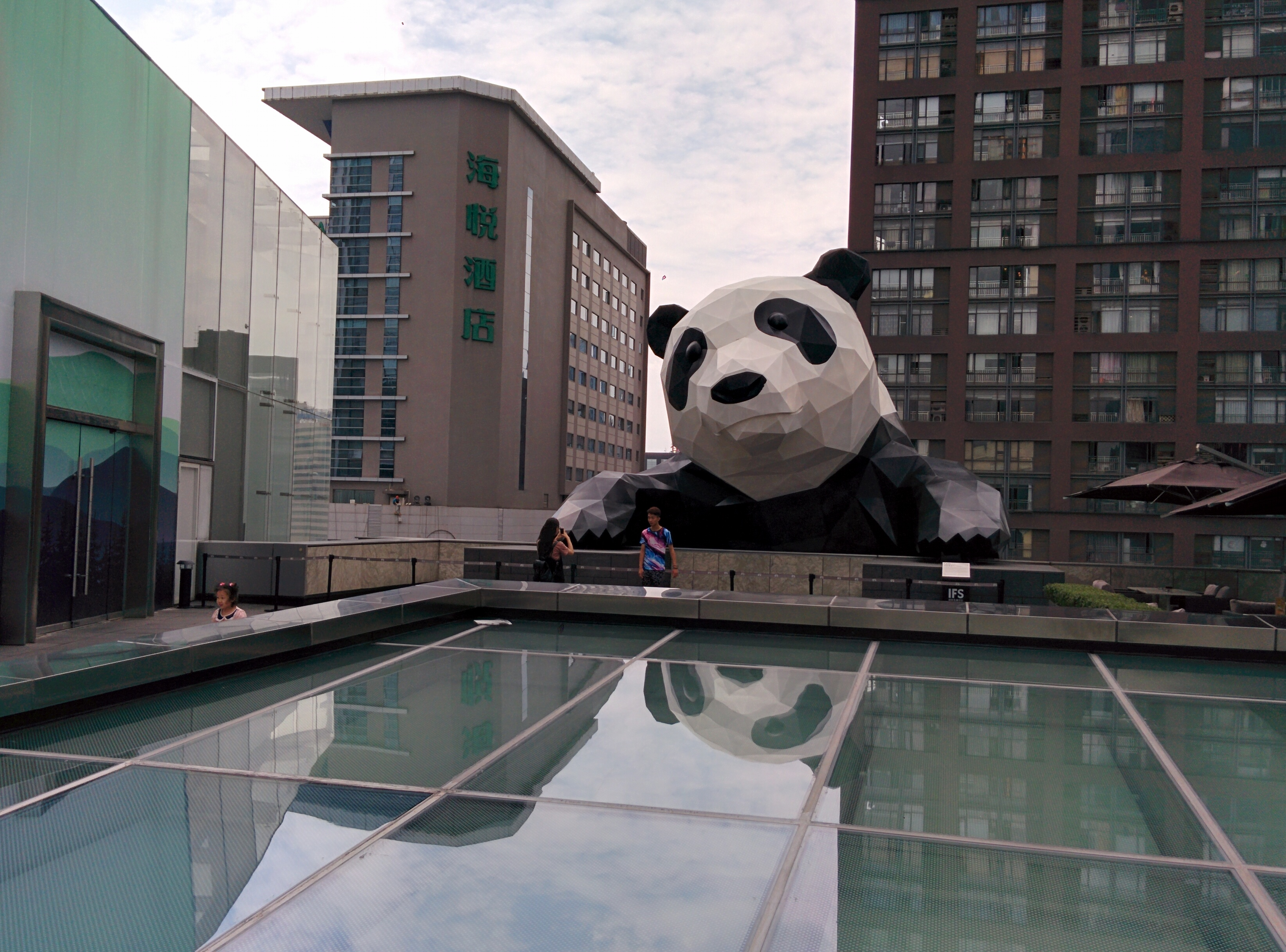 This panda sculpture, titled I AM HERE, adorns the top of the IFS building at Chunxi Road, Chengdu