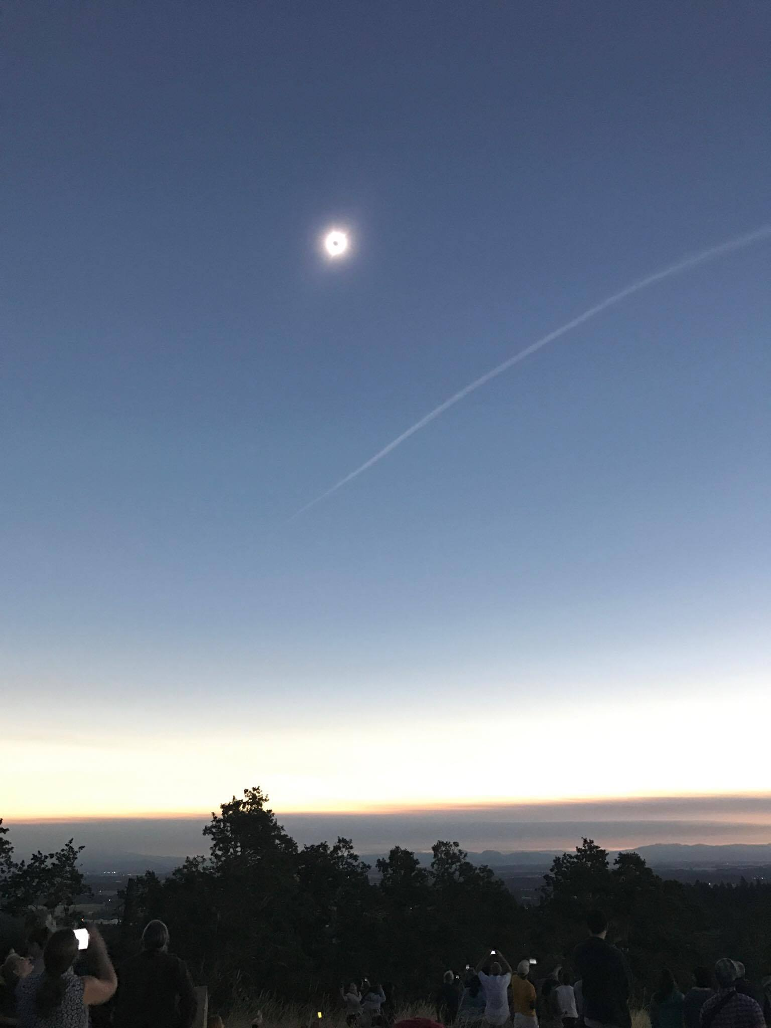 Totality over Chip Ross Park, accompanied by a jet contrail.
