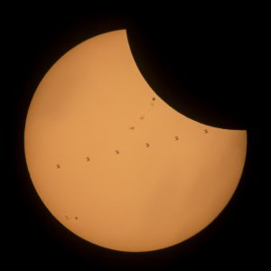 The International Space Station is seen in this composite photo transiting the sun during the eclipse.